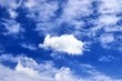 Beautiful white fluffy cloud formations on a blue sky taken in spring