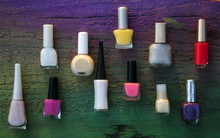 Assorted Nail Polishes On Wood...