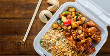 Chinese Take Out With Fried Rice And General Tsos Chicken On Table Top Panorama