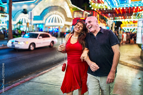 mature couple sightseeing in downtown las vegas streets Poster Mural XXL