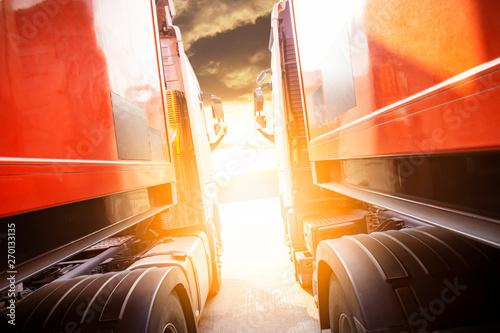 Fotografie, Obraz  truck transportation. semi truck trailer with sunlight at sunset.