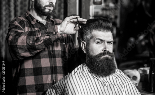 Beard man in barbershop. Hairstylist serving client at barber shop, bearded. Hairdresser, bearded man. Vintage barbershop, shaving. Man hairstylist. Black and white