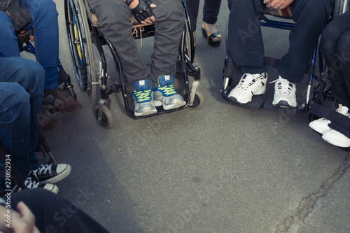 Foto  legs of people in wheelchairs
