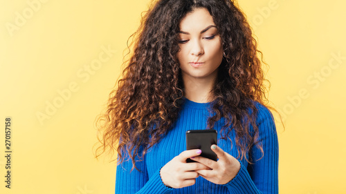 Young woman looking at smartphone Canvas Print