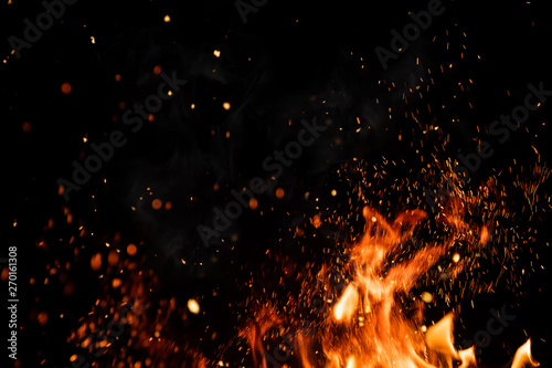 Detail of fire sparks isolated on black background Canvas Print