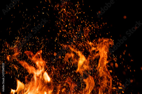 Keuken foto achterwand Vuur Detail of fire sparks isolated on black background