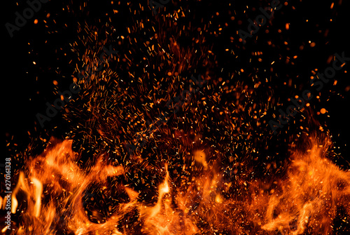 Wall Murals Fire / Flame Detail of fire sparks isolated on black background