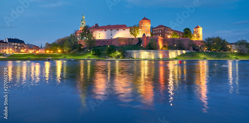 Poland, Krakow, Wawel hill at night, panoramic view from the other bank of river