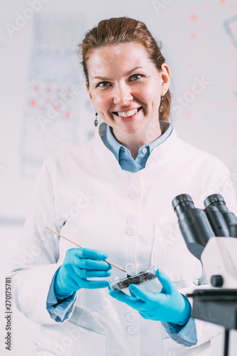 Portrait of Young Female Archaeologist in Laboratory