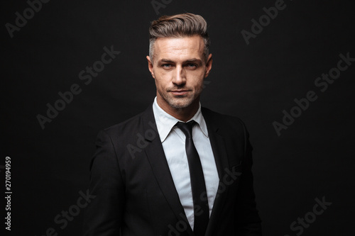 Foto auf Leinwand Texturen Handsome mature business man posing isolated over black wall background.