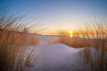 Fototapeta Do hotelu Zachód słońca na plaży
