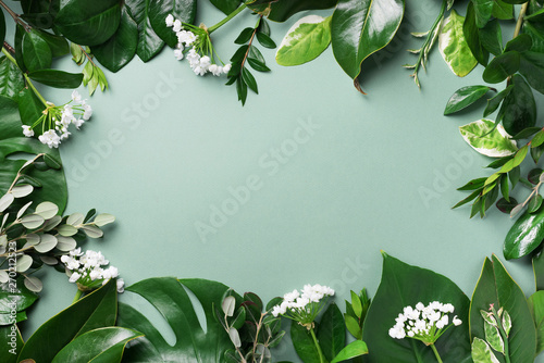 Wall Murals Floral Creative layout made of tropical green leaves. Flat lay. Top view. Summer or spring nature concept. Blank for advertising card or invitation. Mock up