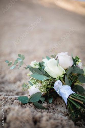 wedding bouquet with roses on sand