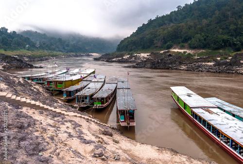 Foto op Aluminium Arctica Long boat on Mekong river, Laos