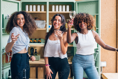 three multiracial women standing and drinking in modern pub Canvas Print