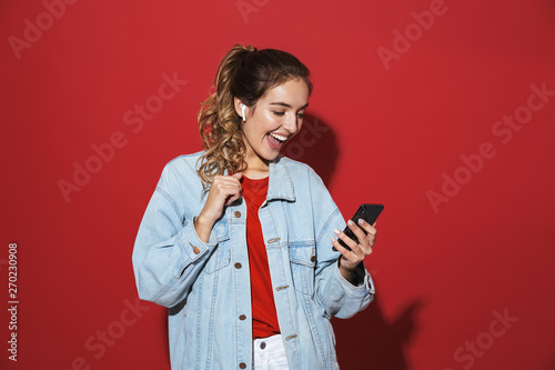 Portrait of a cheerful stylish young woman - 270230908
