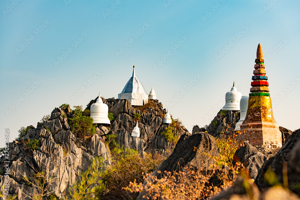 Fototapeta Wat chaloem phrachomklao rachanuson that the tample and pagoda on rock mountain in sunshine beautiful. Architecture landmark Lampang,Thailand