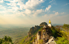 Wat Chaloem Phrachomklao Rachanuson That The Tample And Pagoda On Rock Mountain In Sunshine Beautiful. Architecture Landmark Lampang,Thailand