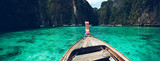 Fototapeta See - Long-tail boat travel to the island,Phi Phi Island,Blue sea