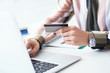 Female office worker hands holding credit card, typing on the keyboard of laptop, online shopping detail close up.