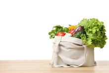 Cloth Bag With Vegetables On Table Against White Background. Space For Text