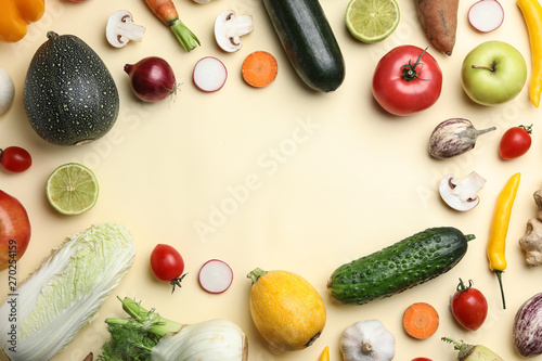 Flat lay composition with fresh vegetables and fruits on color background. Space for text