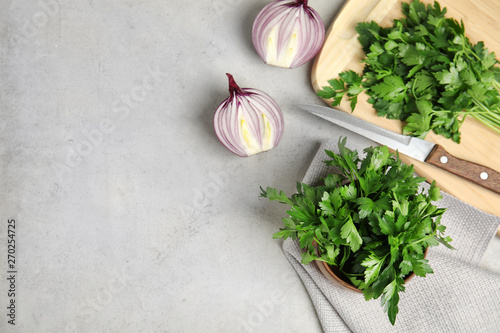 Fototapeta Flat lay composition with fresh green parsley and space for text on grey background obraz