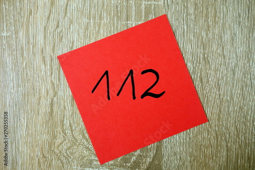 Fototapety, obrazy: Emergency number 112 written on small red sticker