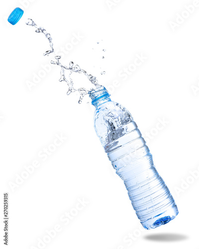 Foto Water splash out of bottle isolated on white background.