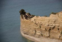 Natural Colorful Stone Layer. Steep Cliff In Sidari Corfu Island  Greece