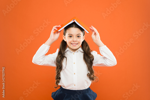 Kid school uniform hold book  Excited about knowledge  Life