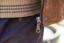 An Old Metal Dog With A Zipper. Decorative Element On The Jacket. Open The Zipper On The Vest.
