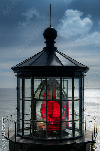 Fotografie, Obraz Red light reflecting through the fresnel lens in the cupola of a lighthouse - Ca