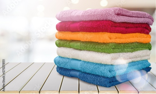 Stampa su Tela Pile of  fluffy towels on background
