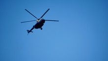 Blue And Silver Police Helicopter Flying Above