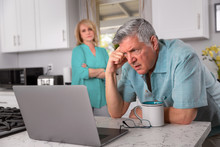 Retired Senior Couple Upset And Worried, Concerned Reading Email On Laptop Computer