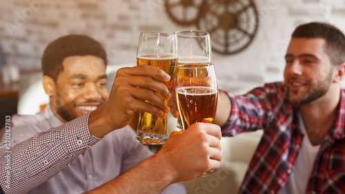Photo  Happy Friends Clinking Beer Glasses, Celebrating Meeting