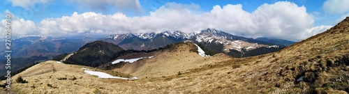 Panoramic mountains landscape in early spring - snow in the mountains