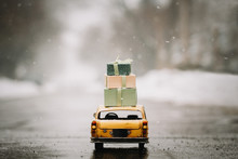 Miniature Yellow Taxi Carrying Gifts Boxes