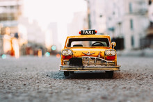 Miniature Yellow Taxi Cab On The Street