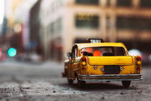 Miniature Yellow Taxi Cab In The City