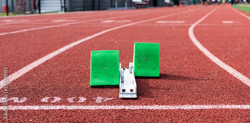 Fotografia  Starting blocks at the 400m start on a red track