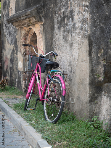 Fototapety, obrazy: Pink city bicycle next to vintage cracked wall.