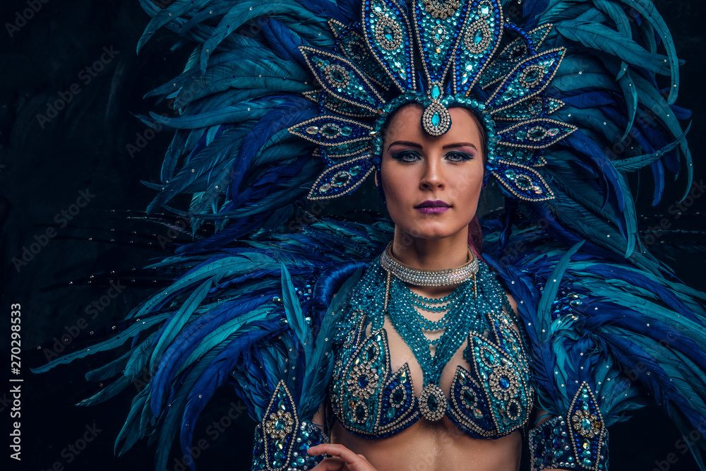 Fototapety, obrazy: Happy brasil dancer is posing for photographer. She is wearing blue feather costume.