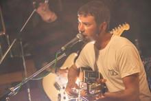 Singer Folk Sings In A Pub