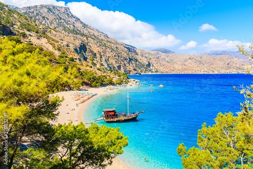 Poster de jardin Europe Méditérranéenne Sailing boat in beautiful bay at Apella beach, Karpathos island, Greece