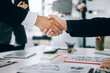 Business people partners shaking hands after complete agreement plan in meeting room, investment concept, success concept