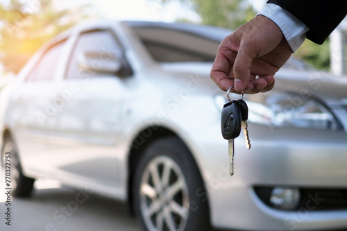 The car owner is standing the car keys to the buyer Fototapet