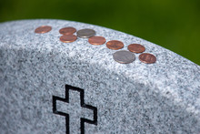 Coins On A Veteran's Headstone