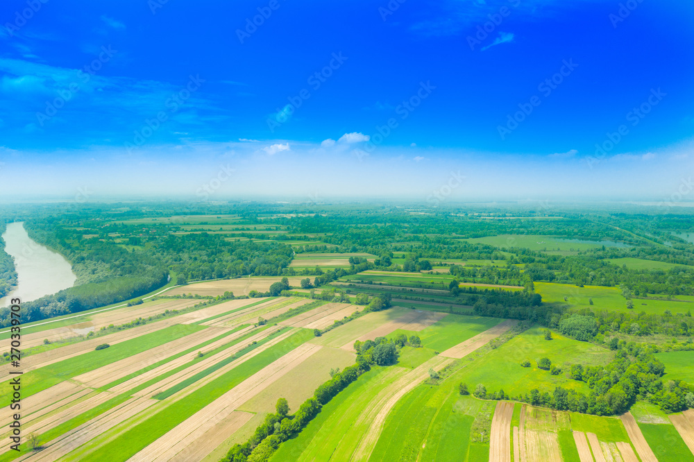 Fototapety, obrazy: Beautiful countryside landscape in nature park Lonjsko polje, Croatia, from air, panoramic view, agriculture fields and flooded field in spring